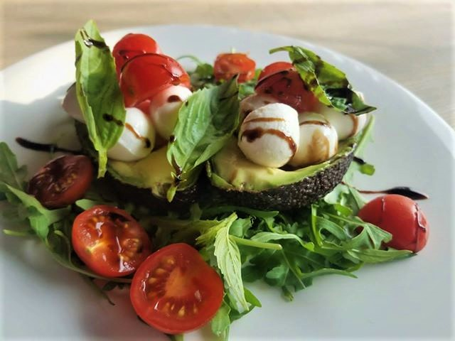 Caprese stuffed avocado salad